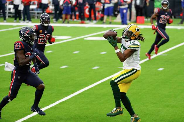 Green Bay Packers wide receiver Davante Adams (17) beats Houston Texans free safety Eric Murray (23) to haul in a 45-yard touchdown reception during the second half an NFL football game at NRG Stadium on Sunday, Oct. 25, 2020, in Houston. Photo: Brett Coomer, Staff Photographer / © 2020 Houston Chronicle