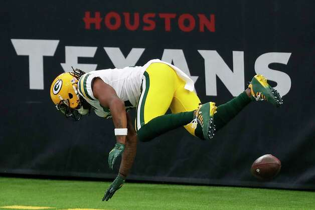 Green Bay Packers wide receiver Davante Adams falls to the turf after throwing the football against the back wall of the end zone after his 45-yard touchdown reception against the Houston Texans during the second half an NFL football game at NRG Stadium on Sunday, Oct. 25, 2020, in Houston. Photo: Brett Coomer, Staff Photographer / © 2020 Houston Chronicle