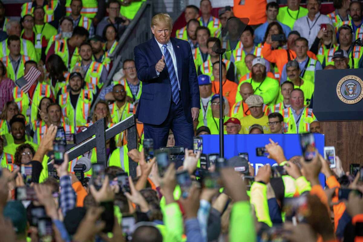 President Donald Trump walks on stage before speaking to a crowd of construction workers before touring Royal Dutch Shell's petrochemical plant in Monaca, Pa. in August. Trump is running on his management of the economy, but data shows that Trump economy before the pandemic was essentially a continuation of the Obama economy.