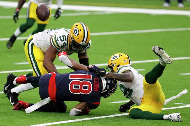 Green Bay Packers linebacker Kamal Martin (54) breaks up a pass intended for Houston Texans wide receiver Randall Cobb (18) during the second half an NFL football game at NRG Stadium on Sunday, Oct. 25, 2020, in Houston. Photo: Brett Coomer, Staff Photographer / © 2020 Houston Chronicle