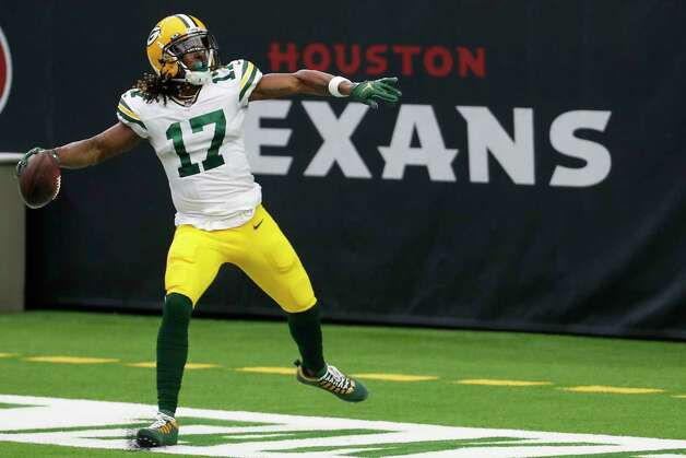Green Bay Packers wide receiver Davante Adams throws the football against the back wall of the end zone after his 45-yard touchdown reception against the Houston Texans during the second half an NFL football game at NRG Stadium on Sunday, Oct. 25, 2020, in Houston. Photo: Brett Coomer, Staff Photographer / © 2020 Houston Chronicle