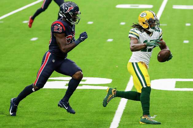 Green Bay Packers wide receiver Davante Adams (17) runs away from Houston Texans free safety Eric Murray (23) on his way to a 45-yard touchdown reception during the second half an NFL football game at NRG Stadium on Sunday, Oct. 25, 2020, in Houston. Photo: Brett Coomer, Staff Photographer / © 2020 Houston Chronicle