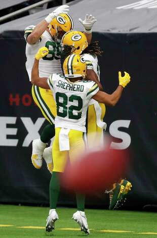 Green Bay Packers tight end Marcedes Lewis (89) and wide receiver Darrius Shepherd (82) celebrate with. wide receiver Davante Adams (17) after Adams beat the Houston Texans defense for a 45-yard touchdown reception during the second half an NFL football game at NRG Stadium on Sunday, Oct. 25, 2020, in Houston. Photo: Brett Coomer, Staff Photographer / © 2020 Houston Chronicle
