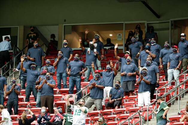 Former Houston Texans players wave to fans as they are introduced during the second half an NFL football game against the Green Bay Packers at NRG Stadium on Sunday, Oct. 25, 2020, in Houston. Photo: Brett Coomer, Staff Photographer / © 2020 Houston Chronicle