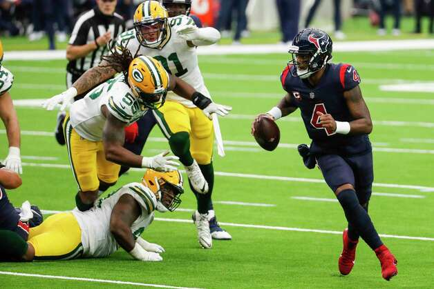 Houston Texans quarterback Deshaun Watson (4) is forced out of the pocket by Green Bay Packers outside linebacker Za'Darius Smith (55), nose tackle Kenny Clark (97) and outside linebacker Preston Smith (91) during the second half an NFL football game at NRG Stadium on Sunday, Oct. 25, 2020, in Houston. Photo: Brett Coomer, Staff Photographer / © 2020 Houston Chronicle