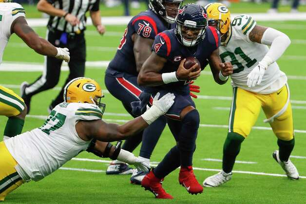 Houston Texans quarterback Deshaun Watson (4) is forced out of the pocket by Green Bay Packers nose tackle Kenny Clark (97) and  outside linebacker Preston Smith (91) during the second half an NFL football game at NRG Stadium on Sunday, Oct. 25, 2020, in Houston. Photo: Brett Coomer, Staff Photographer / © 2020 Houston Chronicle