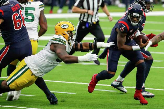 Houston Texans quarterback Deshaun Watson (4) is forced out of the pocket by Green Bay Packers nose tackle Kenny Clark (97) during the second half an NFL football game at NRG Stadium on Sunday, Oct. 25, 2020, in Houston. Photo: Brett Coomer, Staff Photographer / © 2020 Houston Chronicle