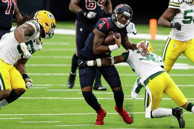 Houston Texans quarterback Deshaun Watson (4) is chased out of the pocket by Green Bay Packers outside linebacker Za'Darius Smith (55) and. defensive back Vernon Scott (36)  during the second half an NFL football game at NRG Stadium on Sunday, Oct. 25, 2020, in Houston. Photo: Brett Coomer, Staff Photographer / © 2020 Houston Chronicle