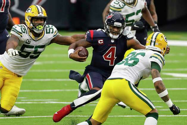 Houston Texans quarterback Deshaun Watson (4) is chased out of the pocket by Green Bay Packers outside linebacker Za'Darius Smith (55) during the second half an NFL football game at NRG Stadium on Sunday, Oct. 25, 2020, in Houston. Photo: Brett Coomer, Staff Photographer / © 2020 Houston Chronicle