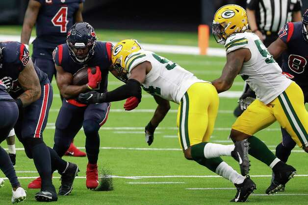 Houston Texans running back David Johnson (31) is stopped at the line of scrimmage by Green Bay Packers defensive end Dean Lowry (94) during the second half an NFL football game at NRG Stadium on Sunday, Oct. 25, 2020, in Houston. Photo: Brett Coomer, Staff Photographer / © 2020 Houston Chronicle