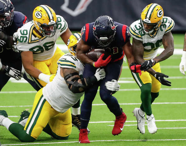 Houston Texans running back David Johnson (31) was stopped at the line by Green Bay Packers cornerback Chandon Sullivan (39) during the second half an NFL football game at NRG Stadium on Sunday, Oct. 25, 2020, in Houston. Photo: Brett Coomer, Staff Photographer / © 2020 Houston Chronicle