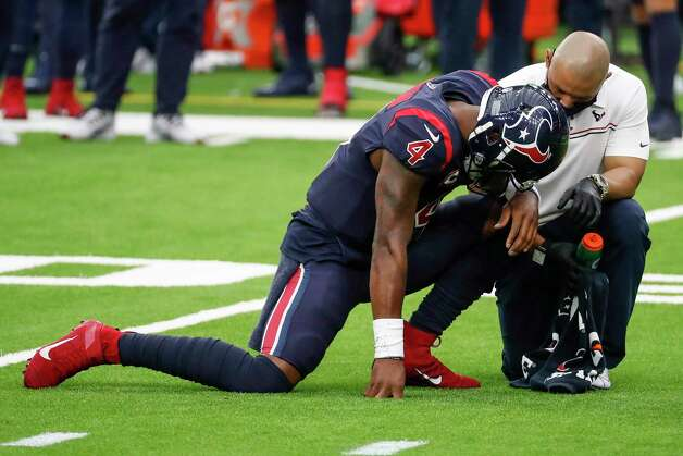 Houston Texans quarterback Deshaun Watson (4) takes a knee during a time out against the Green Bay Packers during the second half an NFL football game at NRG Stadium on Sunday, Oct. 25, 2020, in Houston. Photo: Brett Coomer, Staff Photographer / © 2020 Houston Chronicle