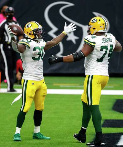 Green Bay Packers running back Jamaal Williams (30) and guard Elgton Jenkins (74) celebrate Williams' 1-yard touchdown run against the Houston Texans during the second half an NFL football game at NRG Stadium on Sunday, Oct. 25, 2020, in Houston. Photo: Brett Coomer, Staff Photographer / © 2020 Houston Chronicle