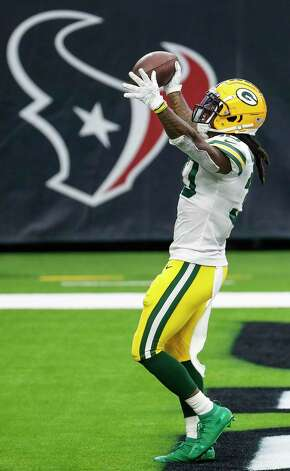 Green Bay Packers running back Jamaal Williams (30) celebrates his 1-yard touchdown run against the Houston Texans during the second half an NFL football game at NRG Stadium on Sunday, Oct. 25, 2020, in Houston. Photo: Brett Coomer, Staff Photographer / © 2020 Houston Chronicle