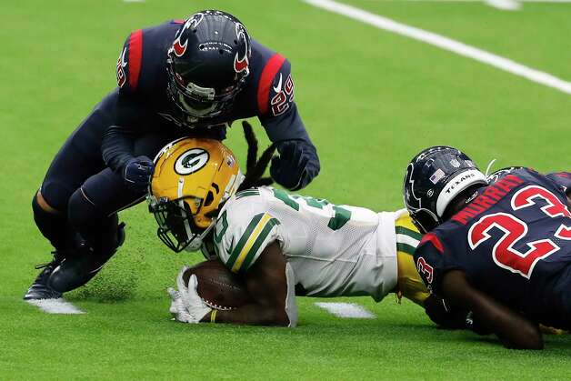 Green Bay Packers running back Jamaal Williams (30) dives toward the goal line as he is stopped by Houston Texans free safety Eric Murray (23) and cornerback Phillip Gaines (29) during the second half an NFL football game at NRG Stadium on Sunday, Oct. 25, 2020, in Houston. Photo: Brett Coomer, Staff Photographer / © 2020 Houston Chronicle