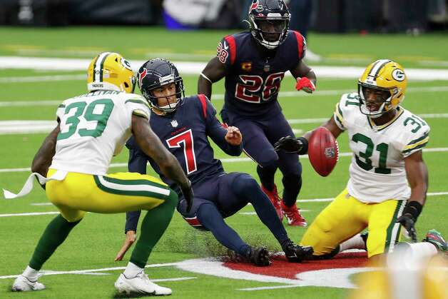 Houston Texans kicker Ka'imi Fairbairn (7) slides on the turf after he goes after an onside kick against Green Bay Packers strong safety Adrian Amos (31) during the second half an NFL football game at NRG Stadium on Sunday, Oct. 25, 2020, in Houston. The Texans recovered the kick. Photo: Brett Coomer, Staff Photographer / © 2020 Houston Chronicle
