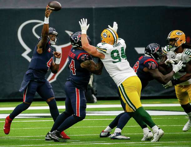 Houston Texans quarterback Deshaun Watson (4) passes over Green Bay Packers defensive end Dean Lowry (94) during the first quarter of an NFL game Sunday, Oct. 25, 2020, at NRG Stadium in Houston. Photo: Jon Shapley, Staff Photographer / © 2020 Houston Chronicle