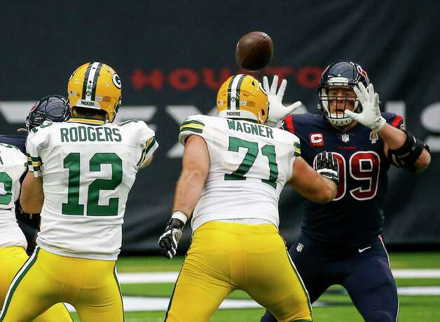 Houston Texans defensive end J.J. Watt (99) tries to block a pass by Green Bay Packers quarterback Aaron Rodgers (12) during the first quarter of an NFL game Sunday, Oct. 25, 2020, at NRG Stadium in Houston. Photo: Jon Shapley, Staff Photographer / © 2020 Houston Chronicle