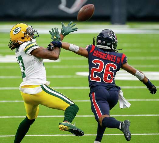 Green Bay Packers wide receiver Davante Adams (17) catches a pass defended by Houston Texans cornerback Vernon Hargreaves III (26) on third down during the first quarter of an NFL game Sunday, Oct. 25, 2020, at NRG Stadium in Houston. Photo: Jon Shapley, Staff Photographer / © 2020 Houston Chronicle