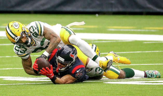 Green Bay Packers cornerback Jaire Alexander (23) tries to strip the ball from Houston Texans wide receiver Will Fuller (15) as he is tackled during the first quarter of an NFL game Sunday, Oct. 25, 2020, at NRG Stadium in Houston. Photo: Jon Shapley, Staff Photographer / © 2020 Houston Chronicle