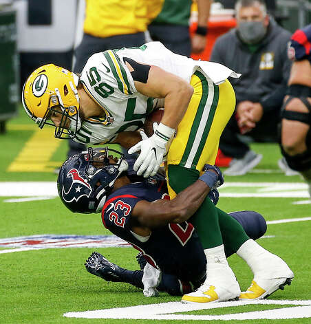 Houston Texans free safety Eric Murray (23) tackles Green Bay Packers' Robert Tonyan (85) during the first quarter of an NFL game Sunday, Oct. 25, 2020, at NRG Stadium in Houston. Photo: Jon Shapley, Staff Photographer / © 2020 Houston Chronicle