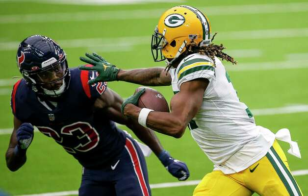 Green Bay Packers wide receiver Davante Adams (17) tries to get by Houston Texans free safety Eric Murray (23) during the first quarter of an NFL game Sunday, Oct. 25, 2020, at NRG Stadium in Houston. Photo: Jon Shapley, Staff Photographer / © 2020 Houston Chronicle
