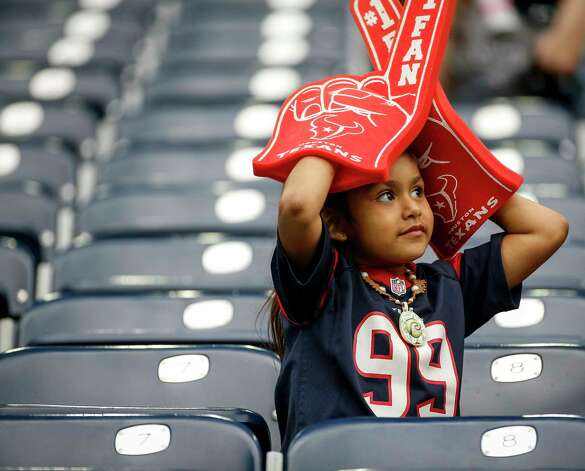 A young Houston Texans fan watches a game against the Green Bay Packers during the first quarter of an NFL game Sunday, Oct. 25, 2020, at NRG Stadium in Houston. Photo: Jon Shapley, Staff Photographer / © 2020 Houston Chronicle