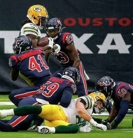 Green Bay Packers running back Jamaal Williams (30) is tackled by Houston Texans inside linebacker Zach Cunningham (41) during the first quarter of an NFL game Sunday, Oct. 25, 2020, at NRG Stadium in Houston. Photo: Jon Shapley, Staff Photographer / © 2020 Houston Chronicle