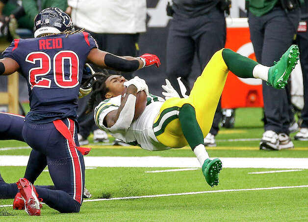 Green Bay Packers running back Jamaal Williams (30) has his helmet knocked off by Houston Texans strong safety Justin Reid (20) during the first quarter of an NFL game Sunday, Oct. 25, 2020, at NRG Stadium in Houston. Photo: Jon Shapley, Staff Photographer / © 2020 Houston Chronicle