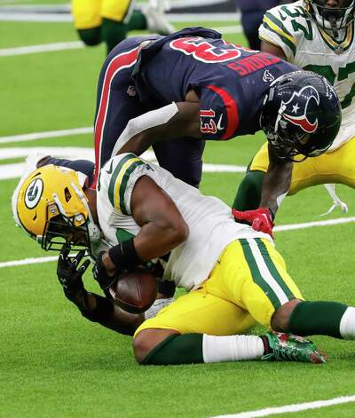 Green Bay Packers strong safety Adrian Amos (31) beats Houston Texans wide receiver Brandin Cooks (13) to the ball to recover a fumble by Texans running back David Johnson for a turnover during the second half an NFL football game at NRG Stadium on Sunday, Oct. 25, 2020, in Houston. Photo: Brett Coomer, Staff Photographer / © 2020 Houston Chronicle