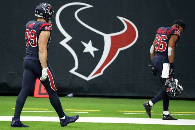 Houston Texans defensive end J.J. Watt (99) and cornerback Vernon Hargreaves III (26) walk off the field after the Texans 35-20 loss to the Green Bay Packers in an NFL football game at NRG Stadium on Sunday, Oct. 25, 2020, in Houston. Photo: Brett Coomer, Staff Photographer / © 2020 Houston Chronicle