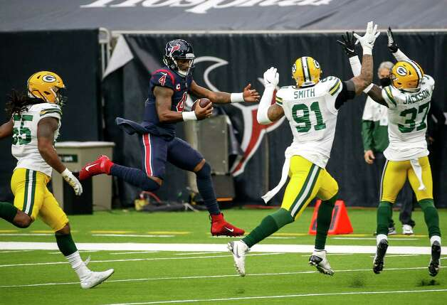 Houston Texans quarterback Deshaun Watson (4) scrambles for a first down while under pressure from Green Bay Packers outside linebacker Za'Darius Smith (55), outside linebacker Preston Smith (91) and cornerback Josh Jackson (37) during the third quarter of an NFL game Sunday, Oct. 25, 2020, at NRG Stadium in Houston. Photo: Jon Shapley, Staff Photographer / © 2020 Houston Chronicle