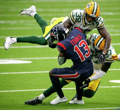 Houston Texans wide receiver Brandin Cooks (13) is brought down by Green Bay Packers cornerback Chandon Sullivan (39) and cornerback Josh Jackson (37) during the third quarter of an NFL game Sunday, Oct. 25, 2020, at NRG Stadium in Houston. Photo: Jon Shapley, Staff Photographer / © 2020 Houston Chronicle