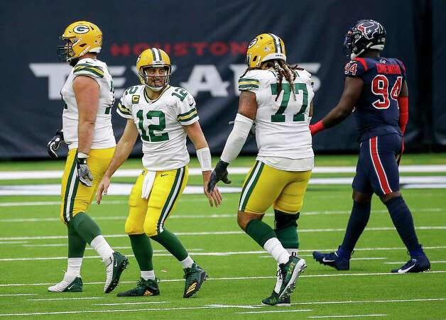 Green Bay Packers quarterback Aaron Rodgers (12) celebrates with offensive tackle Billy Turner (77) after a touchdown during the third quarter of an NFL game Sunday, Oct. 25, 2020, at NRG Stadium in Houston. Photo: Jon Shapley, Staff Photographer / © 2020 Houston Chronicle