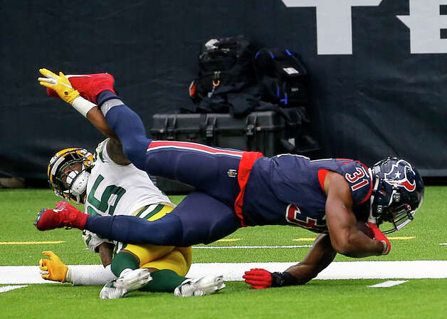 Houston Texans running back David Johnson (31) is brought down by Green Bay Packers safety Will Redmond (25) near the 2-yard line during the third quarter of an NFL game Sunday, Oct. 25, 2020, at NRG Stadium in Houston. Photo: Jon Shapley, Staff Photographer / © 2020 Houston Chronicle