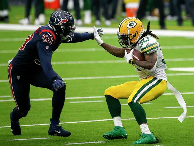 Green Bay Packers running back Jamaal Williams (30) tries to get by Houston Texans outside linebacker Whitney Mercilus (59) during the third quarter of an NFL game Sunday, Oct. 25, 2020, at NRG Stadium in Houston. Photo: Jon Shapley, Staff Photographer / © 2020 Houston Chronicle
