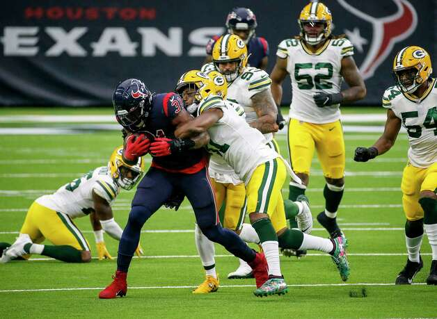 Green Bay Packers strong safety Adrian Amos (31) tries to tackle Houston Texans running back David Johnson (31) during the third quarter of an NFL game Sunday, Oct. 25, 2020, at NRG Stadium in Houston. Photo: Jon Shapley, Staff Photographer / © 2020 Houston Chronicle
