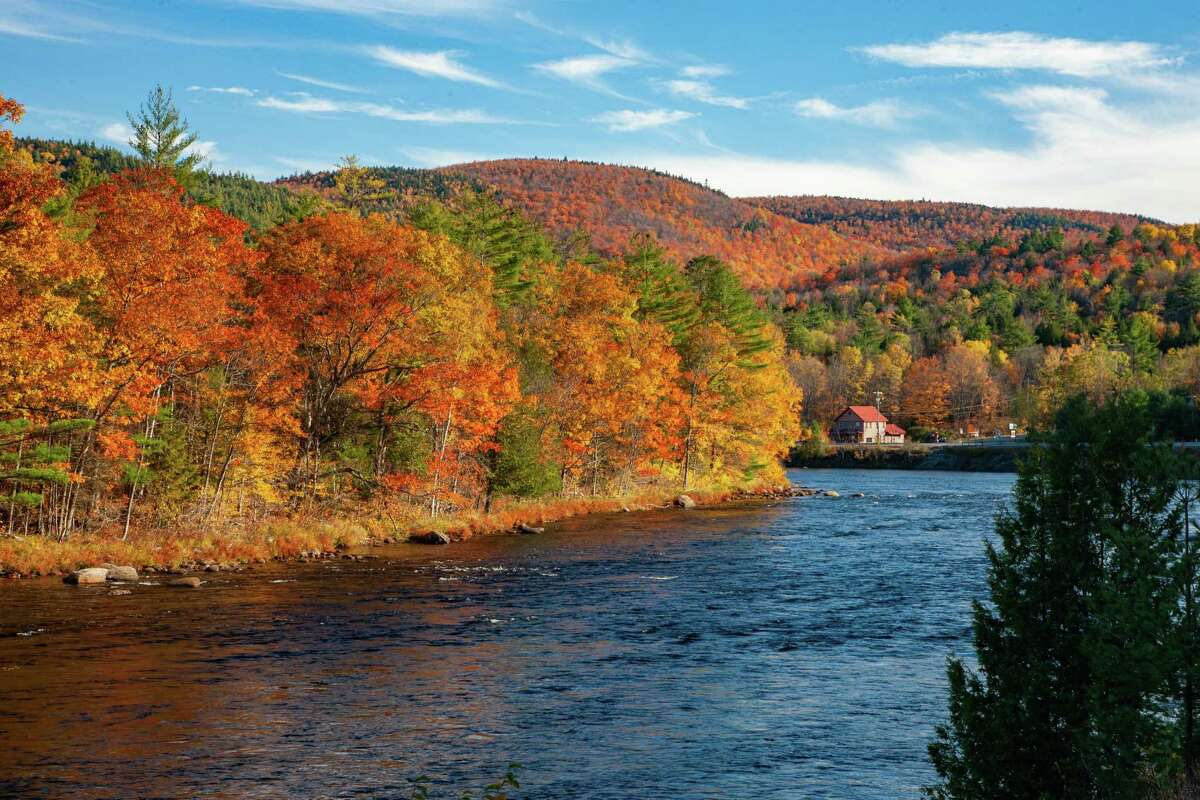 Last weekend I drove up to Long Lake to view the fall foliage before the peak disappears for the season. The return trip to Albany along Route 28 in the late afternoon was spectacular. The lighting was warm bringing out the the beauty of the golds, reds and oranges. This photo shows the upper Hudson River in the foreground and the colors both across the river and on the mountain in the distance. Just awe inspiring and makes me thankful that I live in the great northeast.Ken SchwartzLoudonville