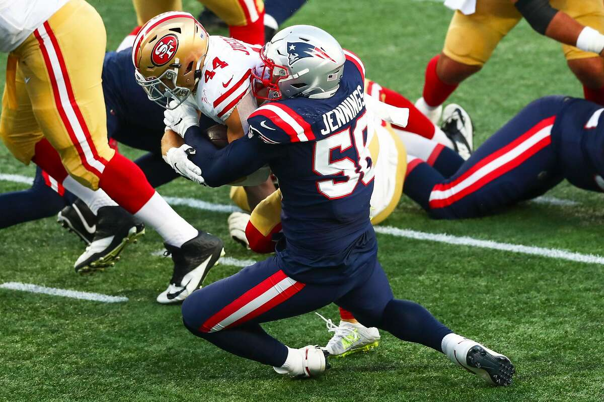 Kyle Juszczyk #44 of the San Francisco 49ers scores a touchdown during the first half of a game against the New England Patriots on October 25, 2020 in Foxborough, Massachusetts.