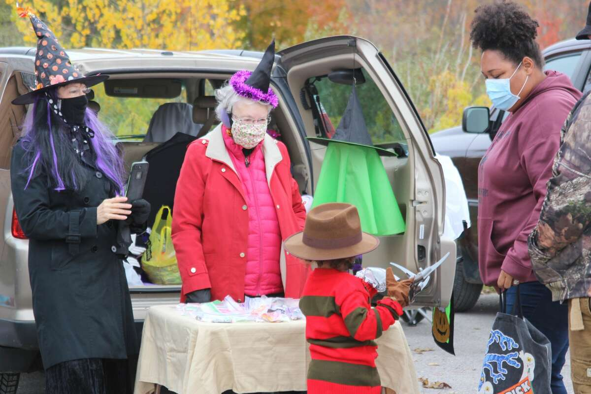 Little Freddy Kruger gets his treats at the  Trunk or Treat at St. Andrews.