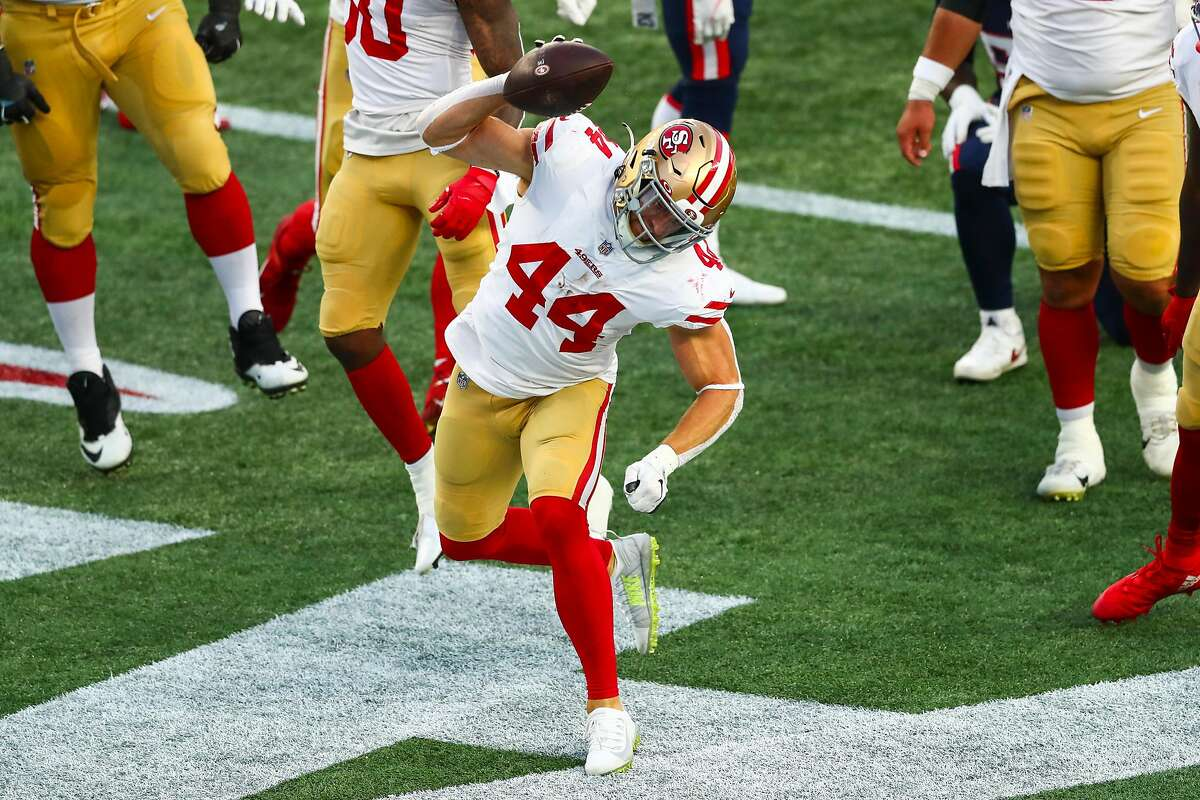 Kyle Juszczyk #44 of the San Francisco 49ers reacts after scoring a touchdown during the first half of a game against the New England Patriots on October 25, 2020 in Foxborough, Massachusetts.