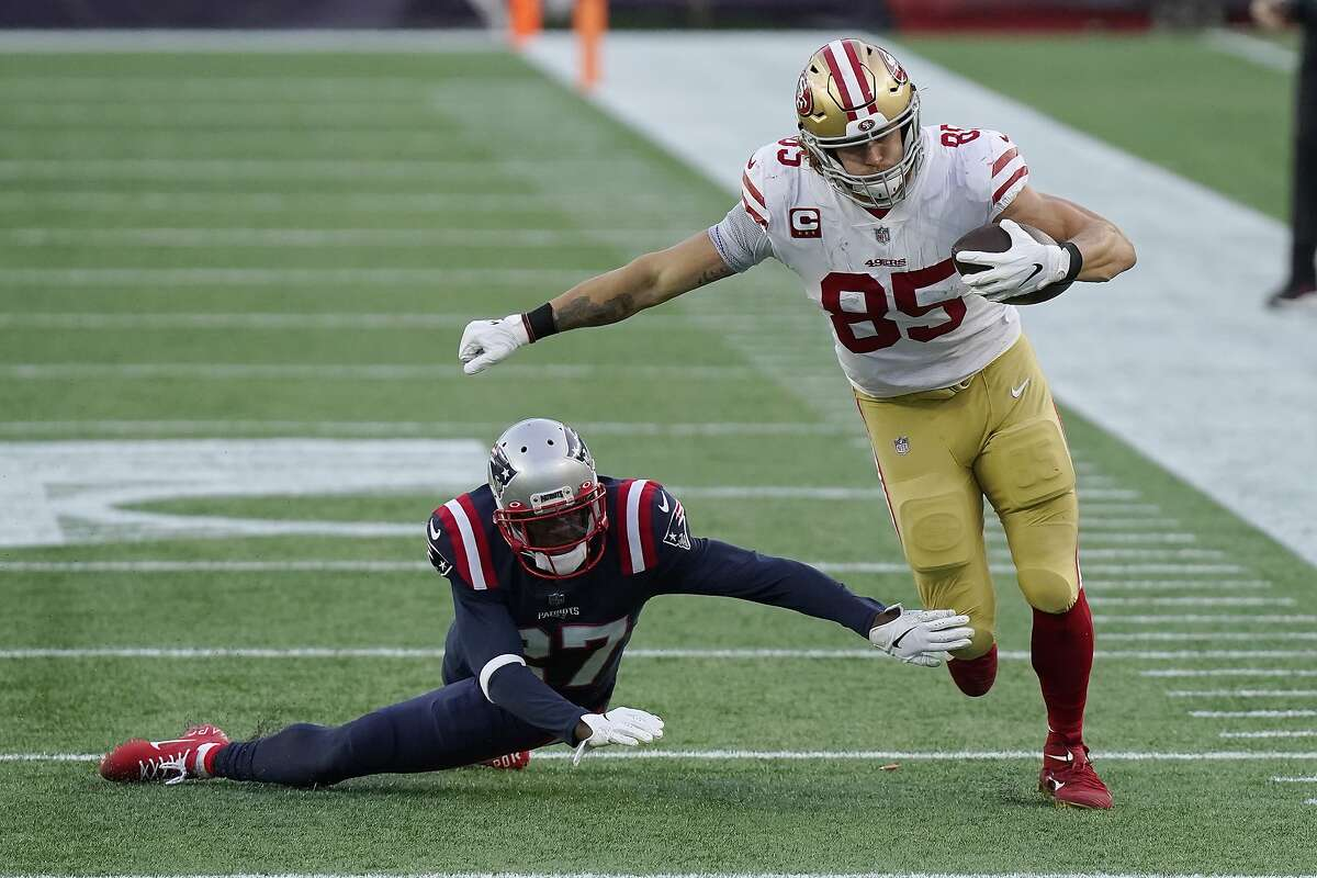 San Francisco 49ers tight end George Kittle (85) eludes New England Patriots defensive back J.C. Jackson (27) after catching a pass in the first half of an NFL football game, Sunday, Oct. 25, 2020, in Foxborough, Mass.