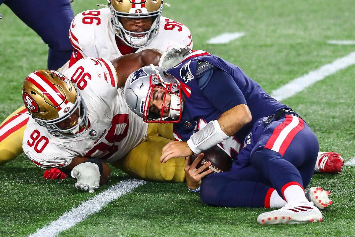 FOXBOROUGH, MASSACHUSETTS - OCTOBER 25: Jarrett Stidham #4 of the New England Patriots is sacked in the fourth quarter by Kevin Givens #90 of the San Francisco 49ers during a game on October 25, 2020 in Foxborough, Massachusetts. (Photo by Adam Glanzman/Getty Images)