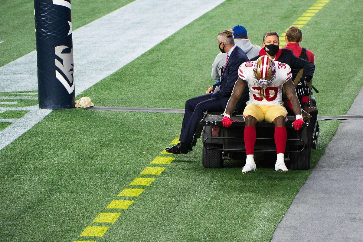 FOXBOROUGH, MA - OCTOBER 25: Jeff Wilson Jr. #30 of the San Francisco 49ers is carted off the field during the game against the New England Patriots in the second half at Gillette Stadium on October 25, 2020 in Foxborough, Massachusetts. (Photo by Kathryn Riley/Getty Images)