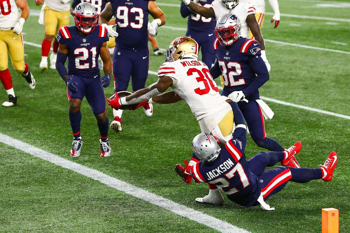 Jeff Wilson #30 of the San Francisco 49ers scores a touchdown in the third quarter of a game against the New England Patriots on October 25, 2020 in Foxborough, Massachusetts.
