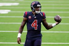 Houston Texans quarterback Deshaun Watson warms up before an NFL football game against the Green Bay Packers at NRG Stadium on Sunday, Oct. 25, 2020, in Houston.