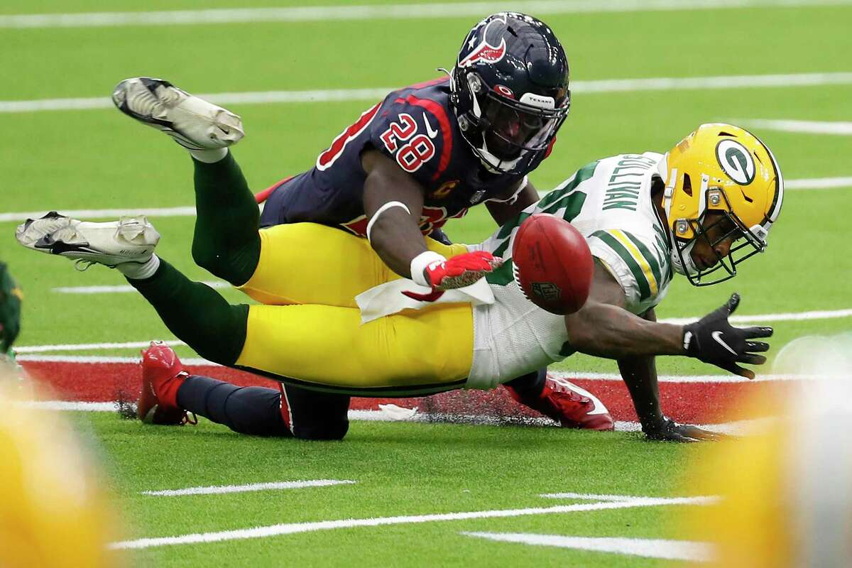 Houston Texans defensive back Michael Thomas (28) and Green Bay Packers cornerback Chandon Sullivan (39) go after an onside kick. during the second half an NFL football game at NRG Stadium on Sunday, Oct. 25, 2020, in Houston. The Texans recovered the kick.