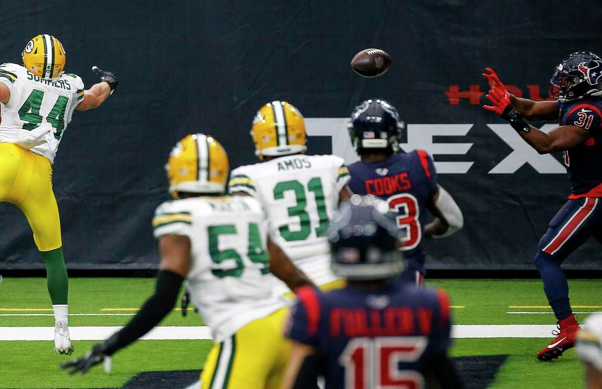 Houston Texans running back David Johnson (31) catches a touchdown pass that got by Green Bay Packers linebacker Ty Summers (44) during the third quarter of an NFL game Sunday, Oct. 25, 2020, at NRG Stadium in Houston.