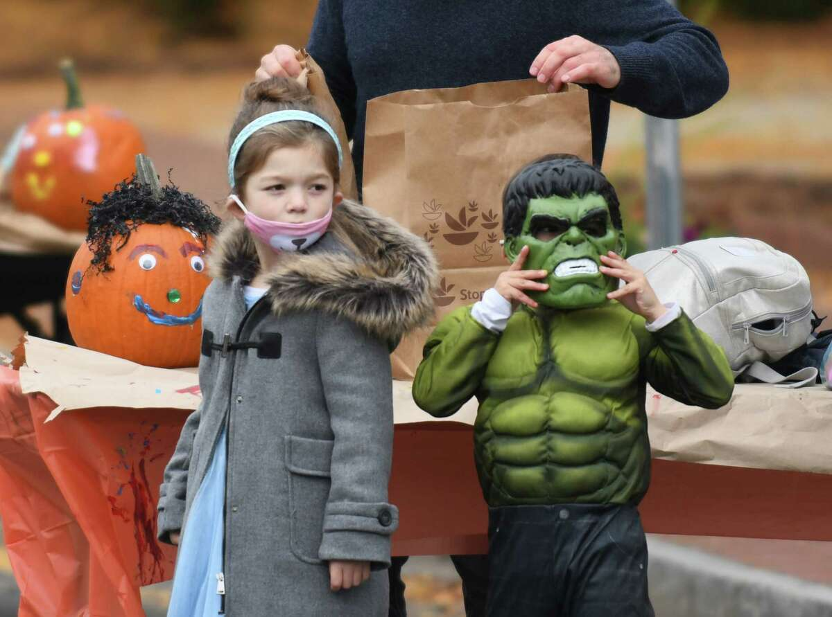 Children are dressed in costumes at the Westport Downtown Merchants Association Halloween Family Pumpkinfest in Westport, Conn. Sunday, Oct. 25, 2020. 150 families dressed in Halloween costumes participated in the socially-distant pumpkin painting event, presented by the Westport Parks & Recreation and Westport Police Athletic League in partnership with the WDMA.