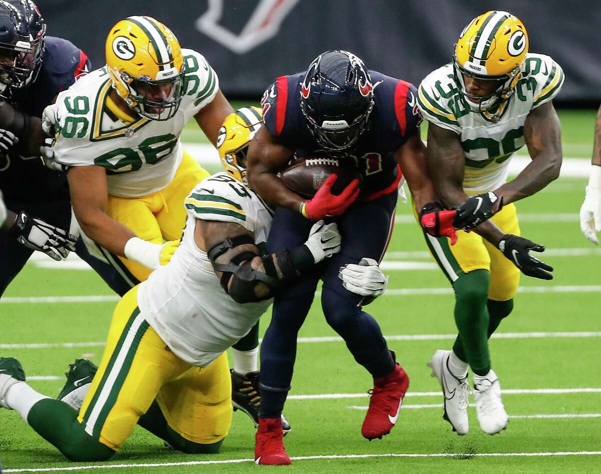 Green Bay's defense takes a Pack mentality in corralling Texans running back David Johnson on a second-half run.